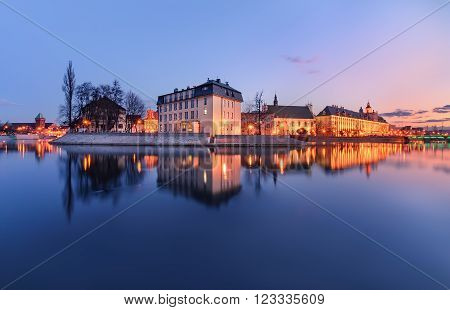 The panorame of Wroclaw cityscape, view from river Odra, after sunset. Poland, Europe.