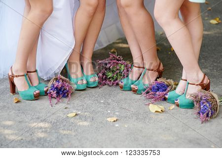 beautiful turquoise shoes of the bride and bridesmaids and wedding bouquets.
