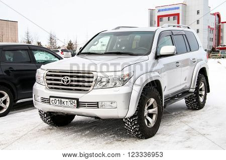 NOVYY URENGOY RUSSIA - MARCH 9 2016: Motor car Toyota Land Cruiser 200 customized by the Arctic Trucks company in the city street.