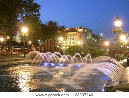 BELGRADE SERBIA-MAY 13: Public fountain with water dispaly is seen on Knez Mihailova Street pedestrian road with people eating in outdoor cafes in downtown Belgrade Serbia on May 13 2015.