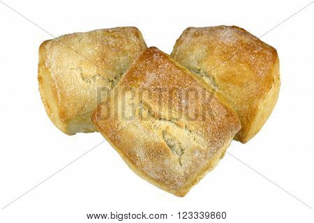 Group of crusty stone baked square white bread rolls.