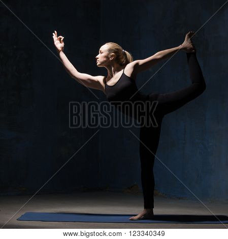 Beautiful Yoga Woman Standing In Natarajasana