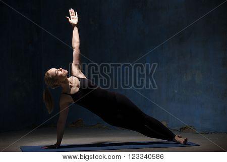 Beautiful Yoga Woman Doing Vasisthasana Pose