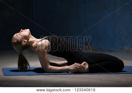 Beautiful Yoga Woman Doing Reclining Hero Pose