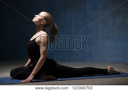 Beautiful Yoga Woman Sitting In Single Pigeon Pose