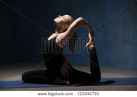 Beautiful Yoga Woman Sitting In One-legged King Pigeon Pose