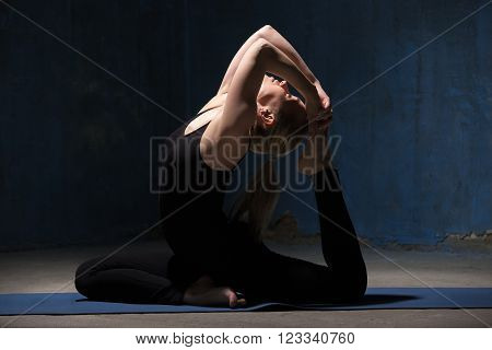Beautiful Yoga Woman Sitting In Eka Pada Rajakapotasana