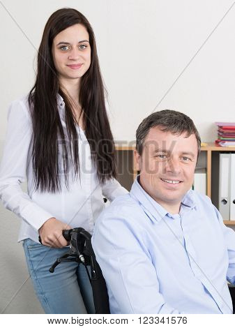 Image of love and support between disabled father and daughter
