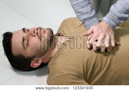 first aid - man doing a cardiopulmonary resuscitation