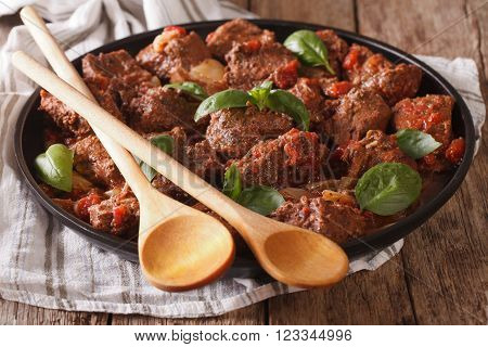 Delicious Greek Food: Stifado Beef With Sauce And Basil Close Up