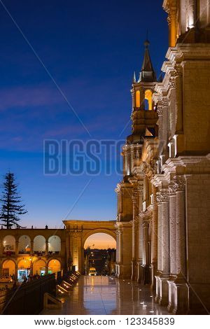 The main square, Plaza de Armas, of Arequipa, famous travel destination and landmark in Peru. Details of the majestic Cathedral glowing in the night. poster