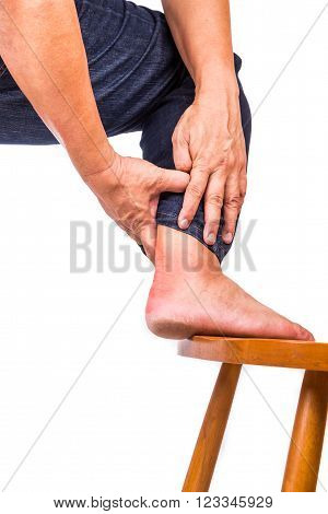 Man With Painful Inflammation At Back Of Foot