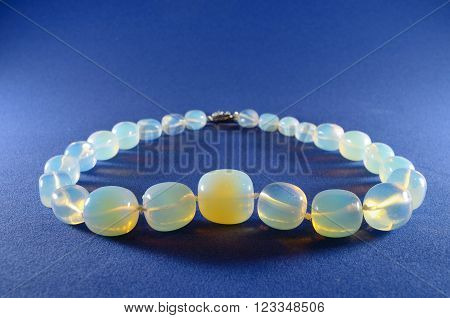 Beads of moonstone adorn to the women.Wearing beads on the neck.
