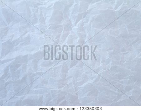 Off white crumpled wax paper sheet background