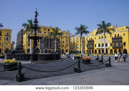 Lima, Peru - January 2, 2015: Fountain in Plaza Mayor (formerly Plaza de Armas) in Lima Peru in sunny day.