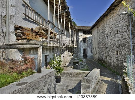 Old derelict buildings in the village of Somp Cornino in Friuli Venezia Giulia Italy. These historic farmhouse buildings date back to the eighteenth century.
