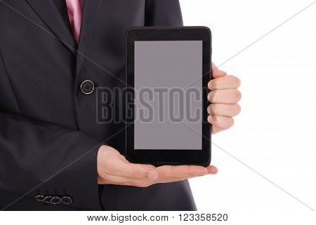 Boy in a black suit hold a tablet PC isolated on white. Cluse-up