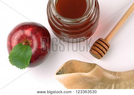 Apple, honey and Shofar on a white background
