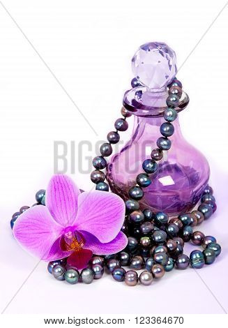 Perfume bottle with flower close up shoot