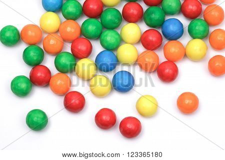 colored bubble gum balls isolated on white, top view