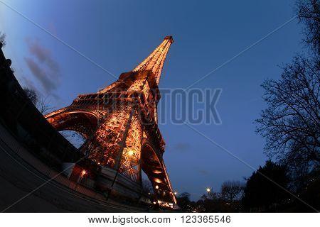 PARIS FRANCE - DECEMBER 23 2009: Eiffel Tower Illuminated at twilight, days before christmas. Fisheye photo.