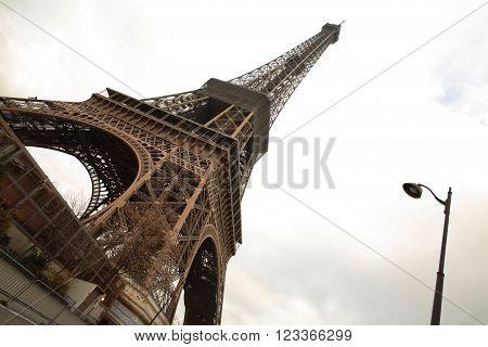 Eiffel tower, Paris, France, against cloudy skies