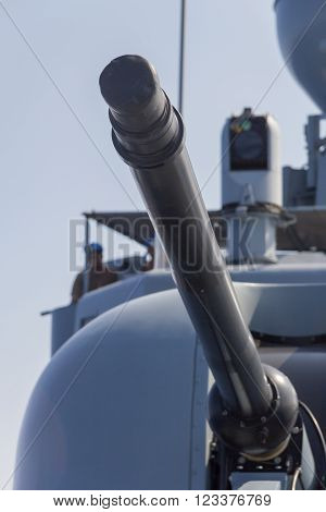 cannon of a warship aims to a target