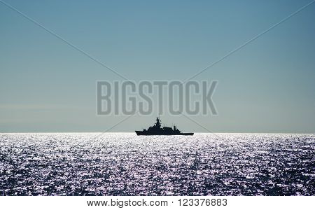 a large black warship in mediterran sea