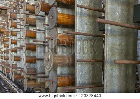 Wooden Bobbins On Rack