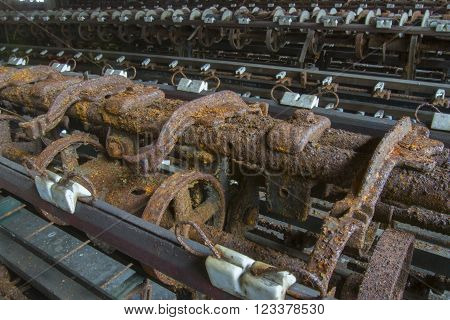 Rusting machinery in abandoned turn of the century silk throwing factory.