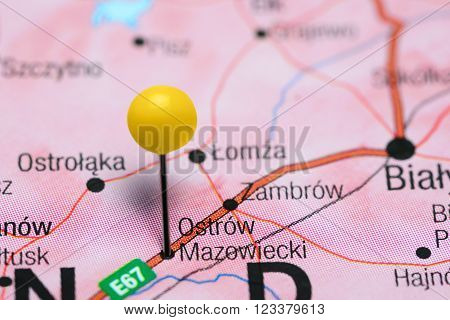 Photo of pinned Ostrow Mazowiecki on a map of Poland. May be used as illustration for traveling theme.