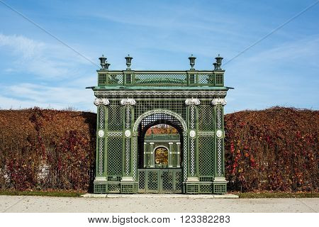 VIENNA, AUSTRIA - OCTOBER 27: Garden Gate at Schloss Schonbrunn on October 27, 2013 in Schonbrunn Palace. The palace and its vast gardens spans over 300 years, reflecting the changing tastes of successive Habsburg monarchs.