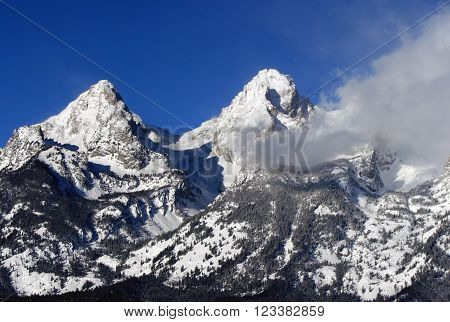 Snow clouds blowing off Grand Tetons South and Middle Peaks  in Grand Tetons National Park in Wyoming USA