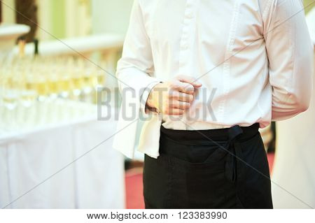Waiter ready to service at party poster