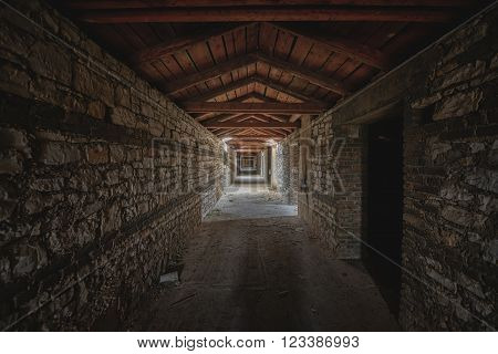Abandoned and desolate passage made out of stone