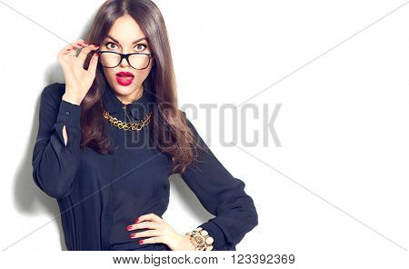 Beauty sexy fashion model girl wearing glasses, isolated on white background. Beautiful young brunette woman with trendy accessories posing in studio