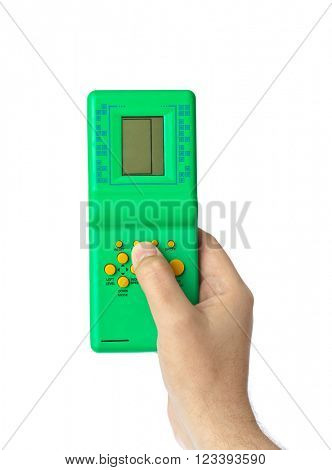Hand with electronic tetris game isolated on white background