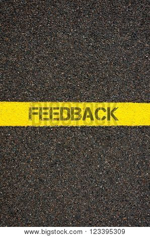 Road marking yellow paint dividing line with word FEEDBACK, concept image