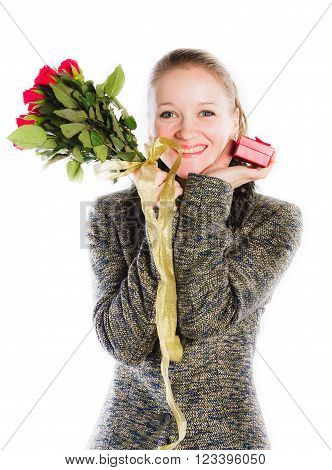 charming  beautiful young woman with the bouquet of red roses on a white background