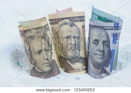 Saving money on quality cost-effective washing powder dollar banknotes in laundry detergent.