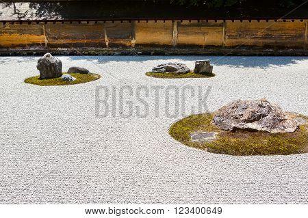 Beautiful and peaceful Stone garden of Ryoan-ji temple in Kyoto, Japan.