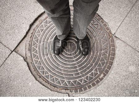 Urbanite Man Standing On Sewer Manhole