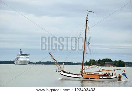 HELSINKI / FINLAND - July 27 2013: Sailing boat and Silja Line vessel near the port of Helsinki