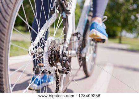 Riding bicycle on a bicycle lane gears in focus ** Note: Shallow depth of field