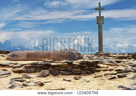 CAPE CROSS NAMIBIA - JAN 31 2016: A memorial stone for Diogo Cao who landed at this spot in 1485 and who erected a stone cross or padrao at this spot