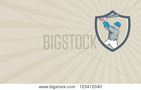 Business card showing illustration of an american baseball player holding bat batting homer home run set inside shield crest on isolated background done in cartoon style.