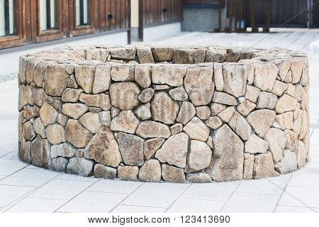 Traditional Ancient empty stone well in japan.