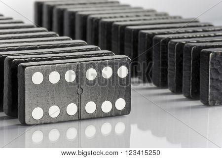 Composition of standing black domino bricks with white dots