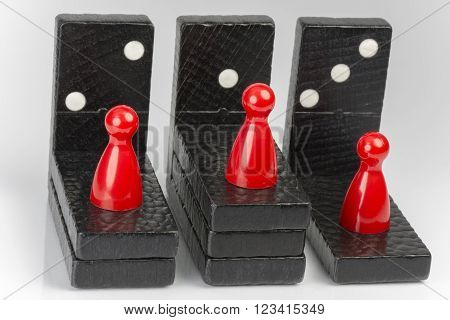 Conceptual composition of lying and standing domino bricks which express competition