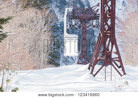 Shinhotaka Ropeway Cable car station Takayama Gifu Japan. allows visitors to take in spectacular views as the crystal-clear blue sky in a grand panoramic view of the Northern Japan Alps. in winter